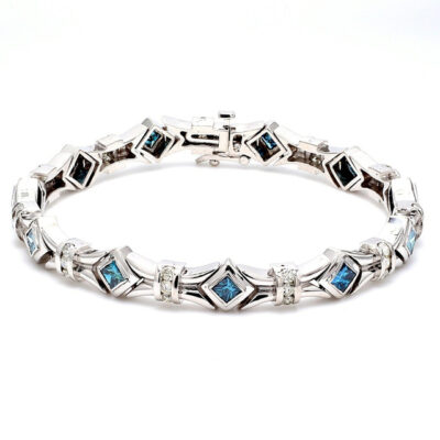 Bracelet in 14K WG w/ white Rounds & blue Princess cut diamonds D1.35ct.t.w.