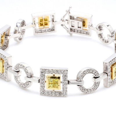 Bracelet in 14K two-tone w/ FY Princess cuts & white Round diamonds D3.10ct.t.w.