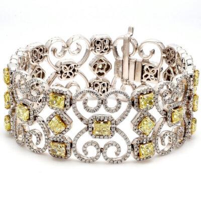Halo Bracelet in 14K WG w/ FY Radiants & Cushions w/ Round diamonds D21.81ct.t.w.