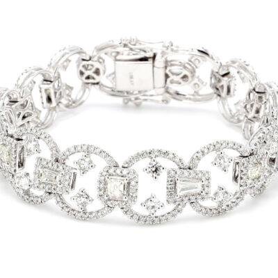 Designer Mracelet in 18K WG w/ Round diamond on the sides & prong set Rounds & Fancy shape centers. D7.48ct.t.w.