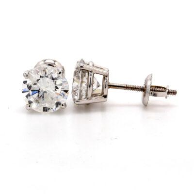 Stud earrings in 14K WG w/ USA certified E/I1 Round diamonds. D3.25ct.t.w.