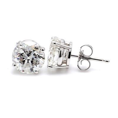 Stud Earrings in 14K WG w/ USA certified D-E/SI3-I1 Round diamonds. D1.30ct.t.w.