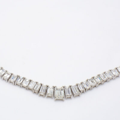 """17"""" Graduated Tennis necklace in Platinum w/ H/SI2 GIA Emerald center D27.98ct.t.w."""