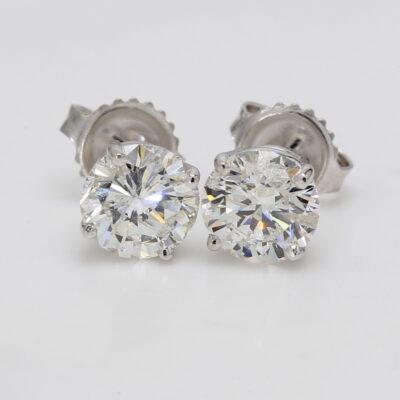 Stud Earrings in 14K WG w/ USA certified F/SI3-I1 Round diamonds. D2.51ct.t.w.