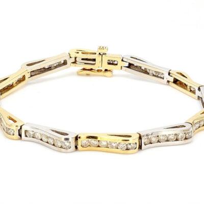 Wave design Bracelet in 14K Two-tone w/ Round diamonds D2.50ct.t.w.