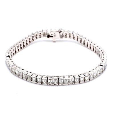 """7"""" Tennis Bracelet in 18K WG w/ channel set (60) Emerald cut diamonds. D11.12ct.t.w."""