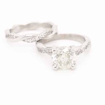 3.15 ctw. Round Cut Diamond Set in a 14kt White Gold Twisted Diamond Setting